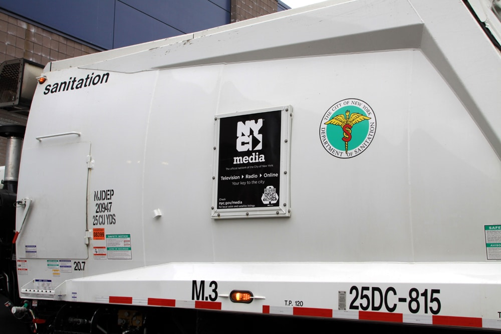 sanitation truck with NYC Media display1 NYC Sanitation Trucks Go High Tech with QR Codes Linked to Recycling Videos